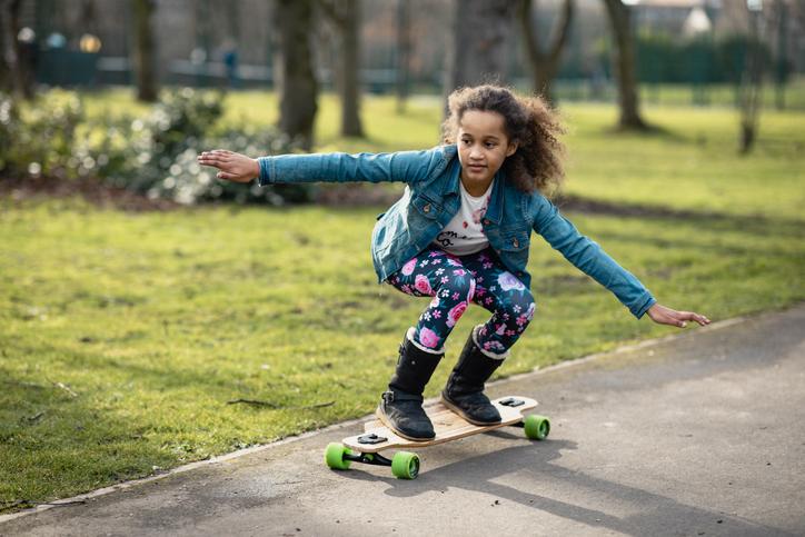 young girl skateboarding