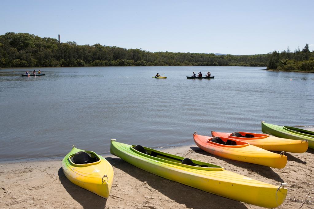 kayak boats near river
