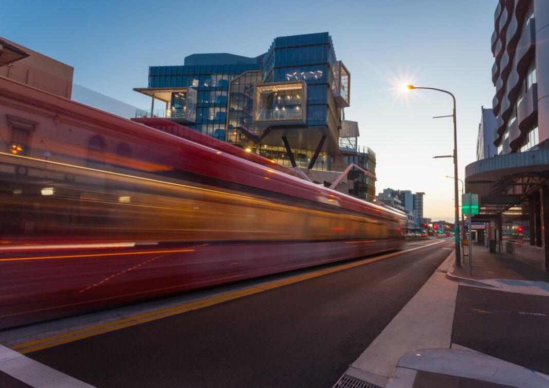 light rail moving quickly through city