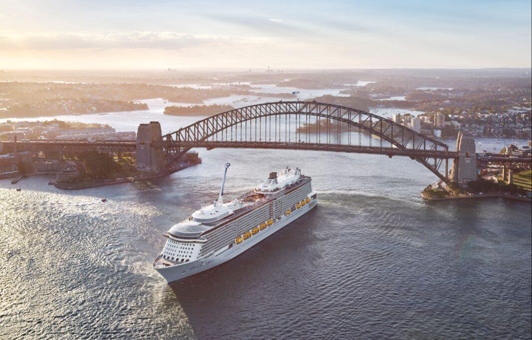 large cruise ship going under sydney harbour bridge