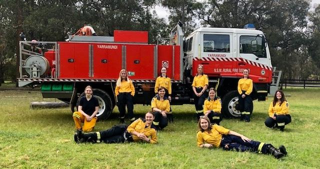 female firefighters near a fire truck