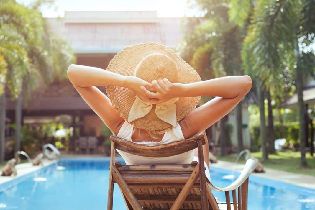 woman in swimwear by the pool