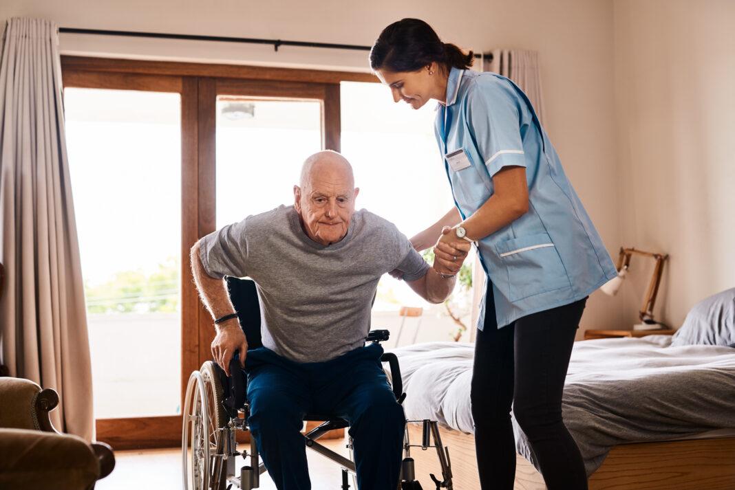 Aged Care nurse helping elderly man