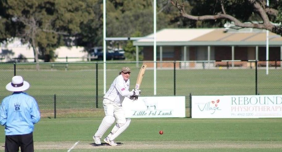 cricket batsman hitting the ball