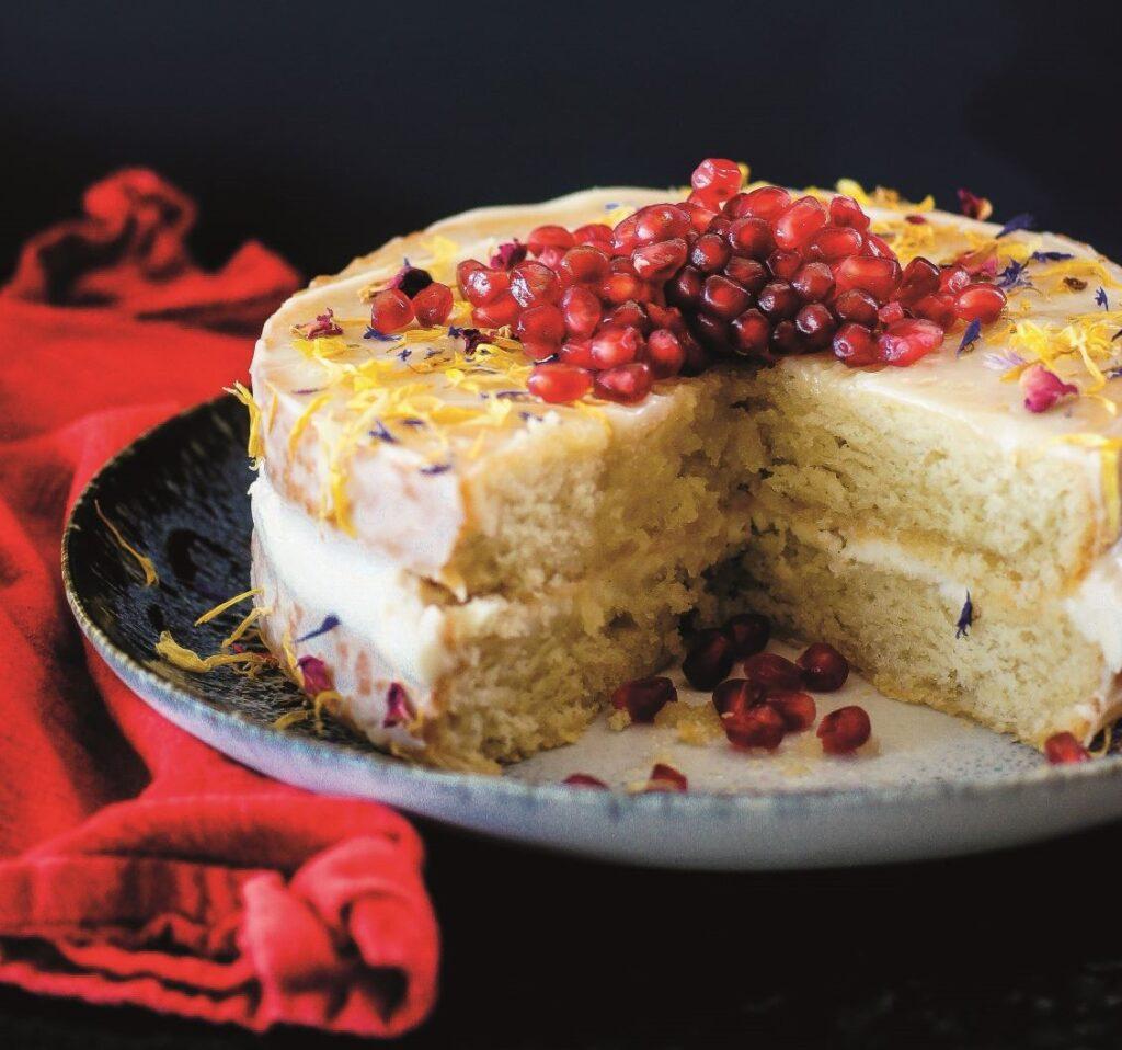 Vegan vanilla sponge cake with cream 'cheese' icing, maple and pomegranate by Katrina Meynink